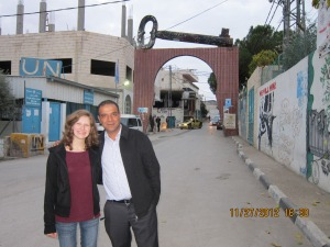 (Emma Bergen stands with Salah Ajarma, a founder of the children's centre, at the entrance to the refugee camp. On the right, is the wall. Metro/Handout)